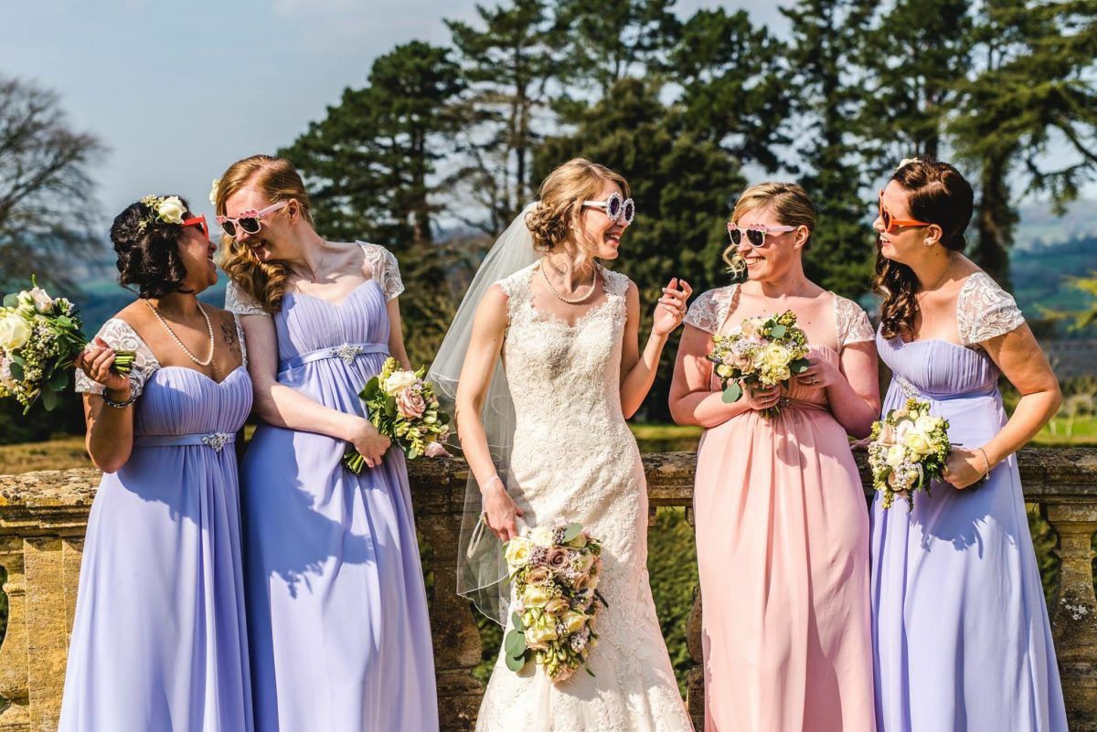 Bride and bridesmaids wearing sunglasses Coombe Lodge near Bristol