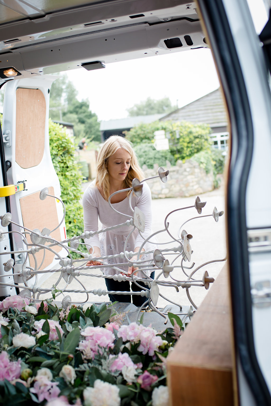 wedding florist loading flowers into van