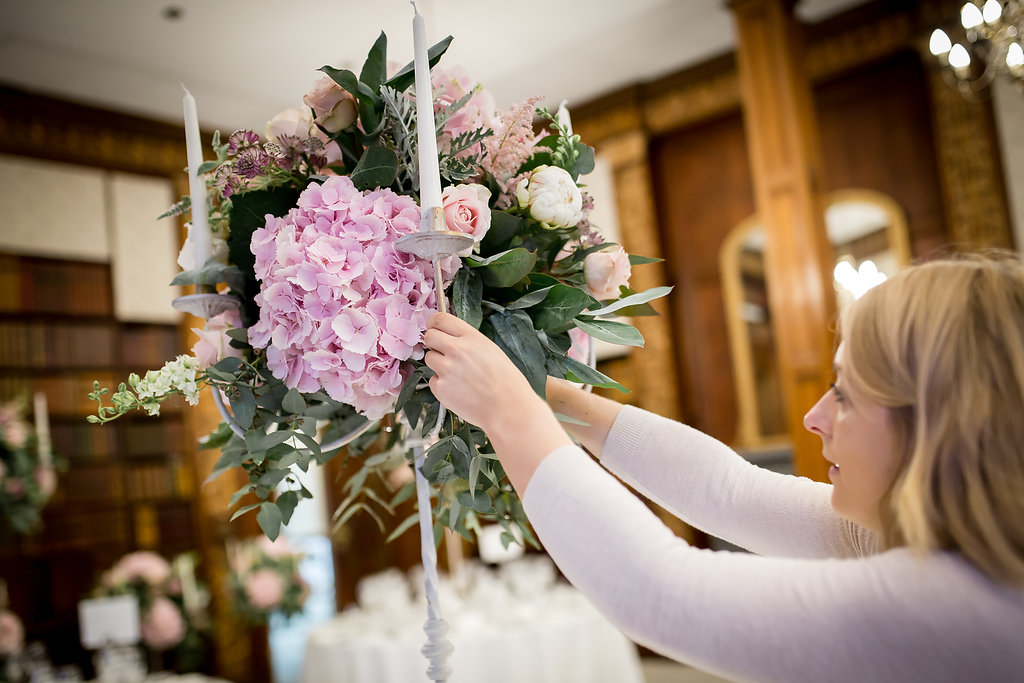 wedding florist working at Clevedon Hall