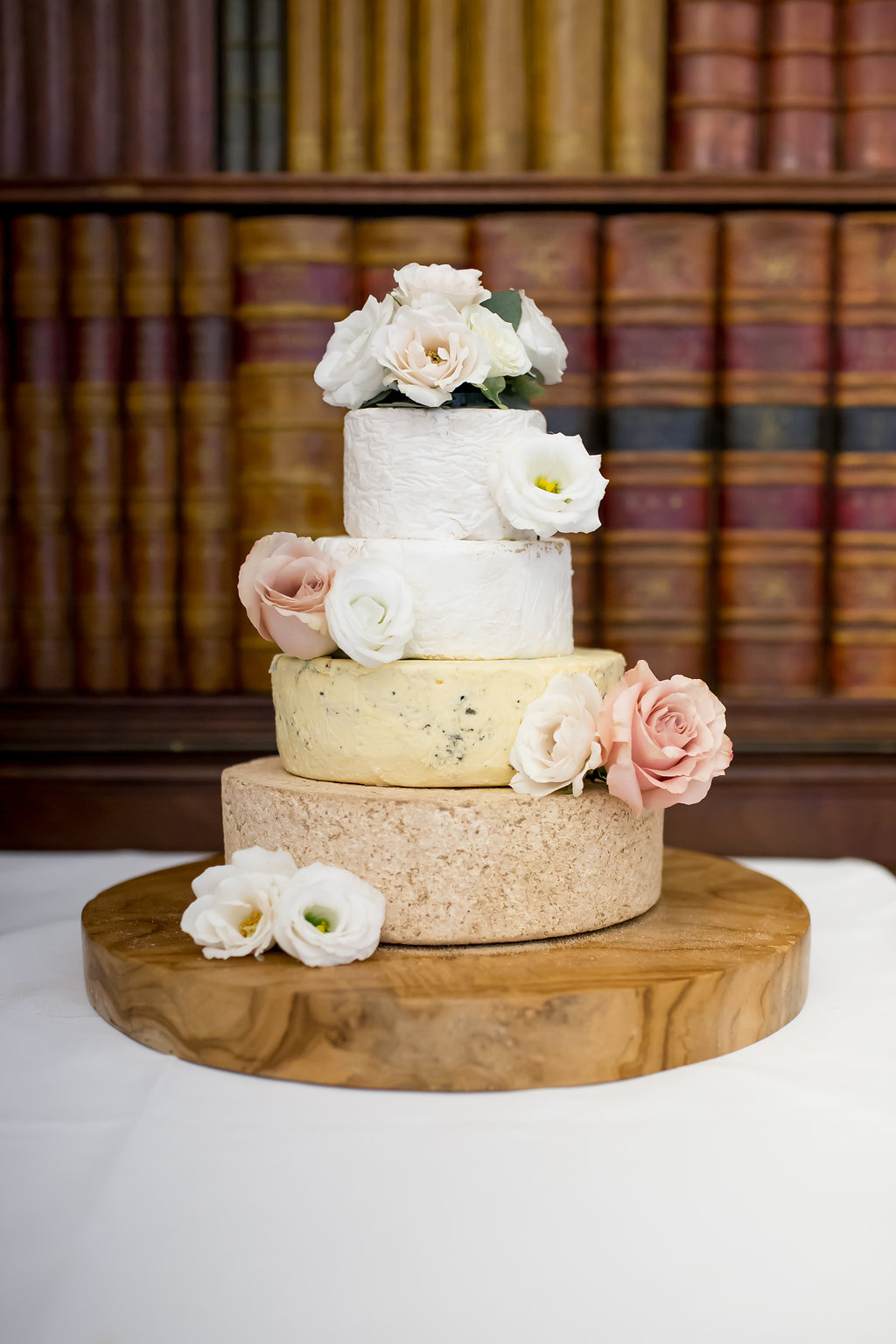 wedding cheese cake decorated with fresh flowers