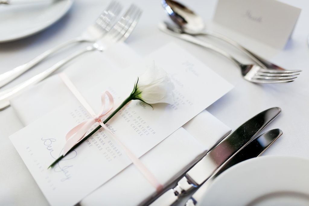 wedding place setting decorated with a single flower