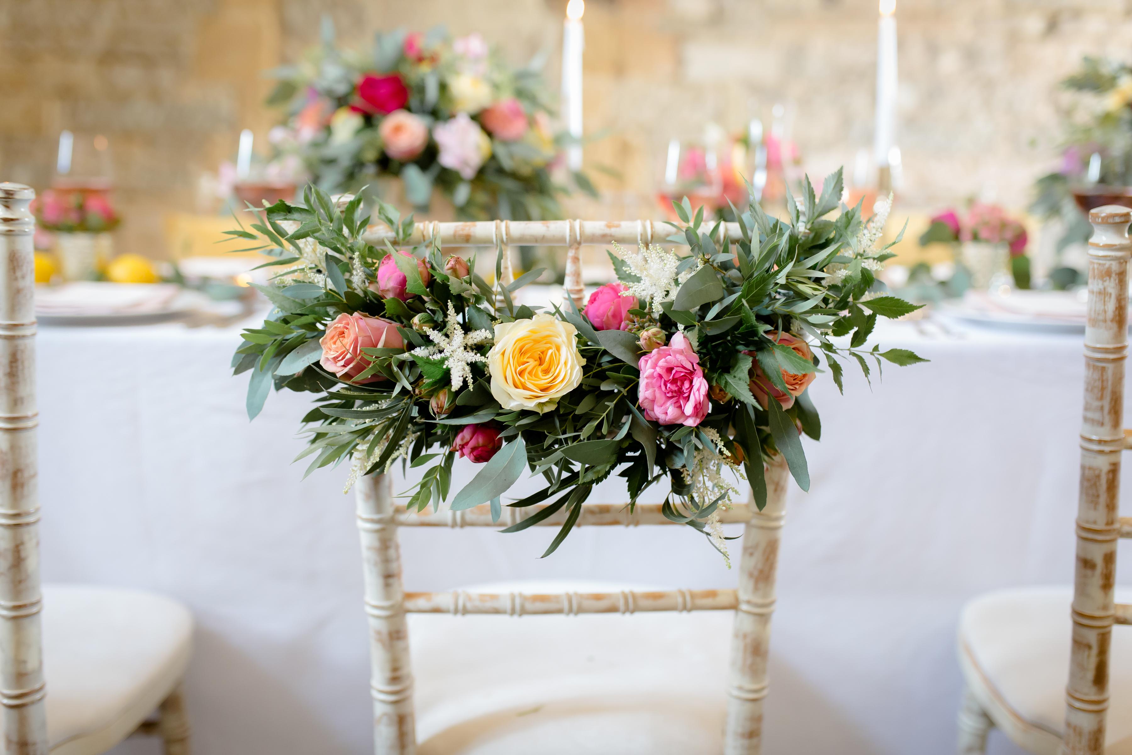 Floral garland wedding chair decor