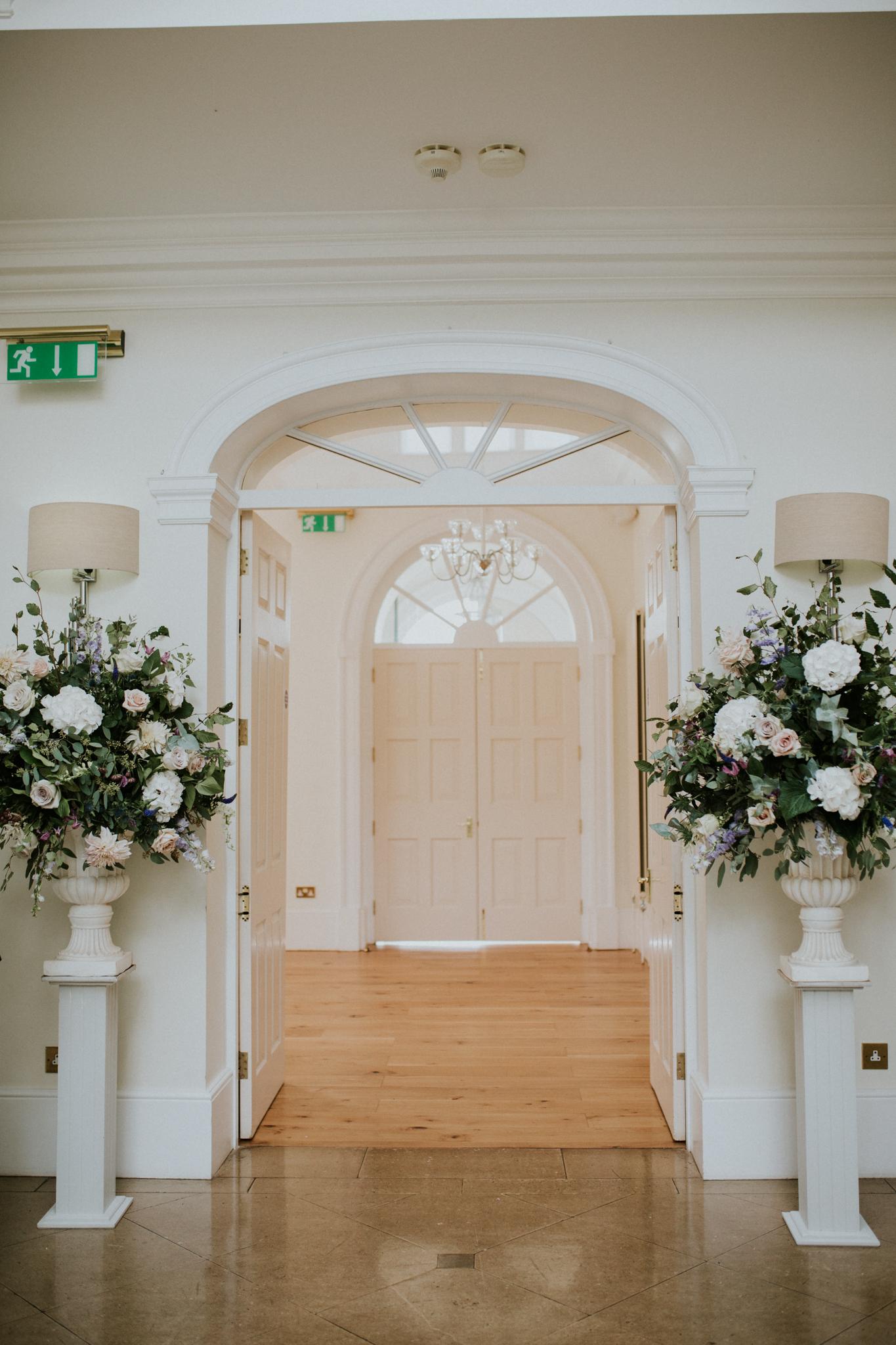 Large white urn arrangements wedding flowers
