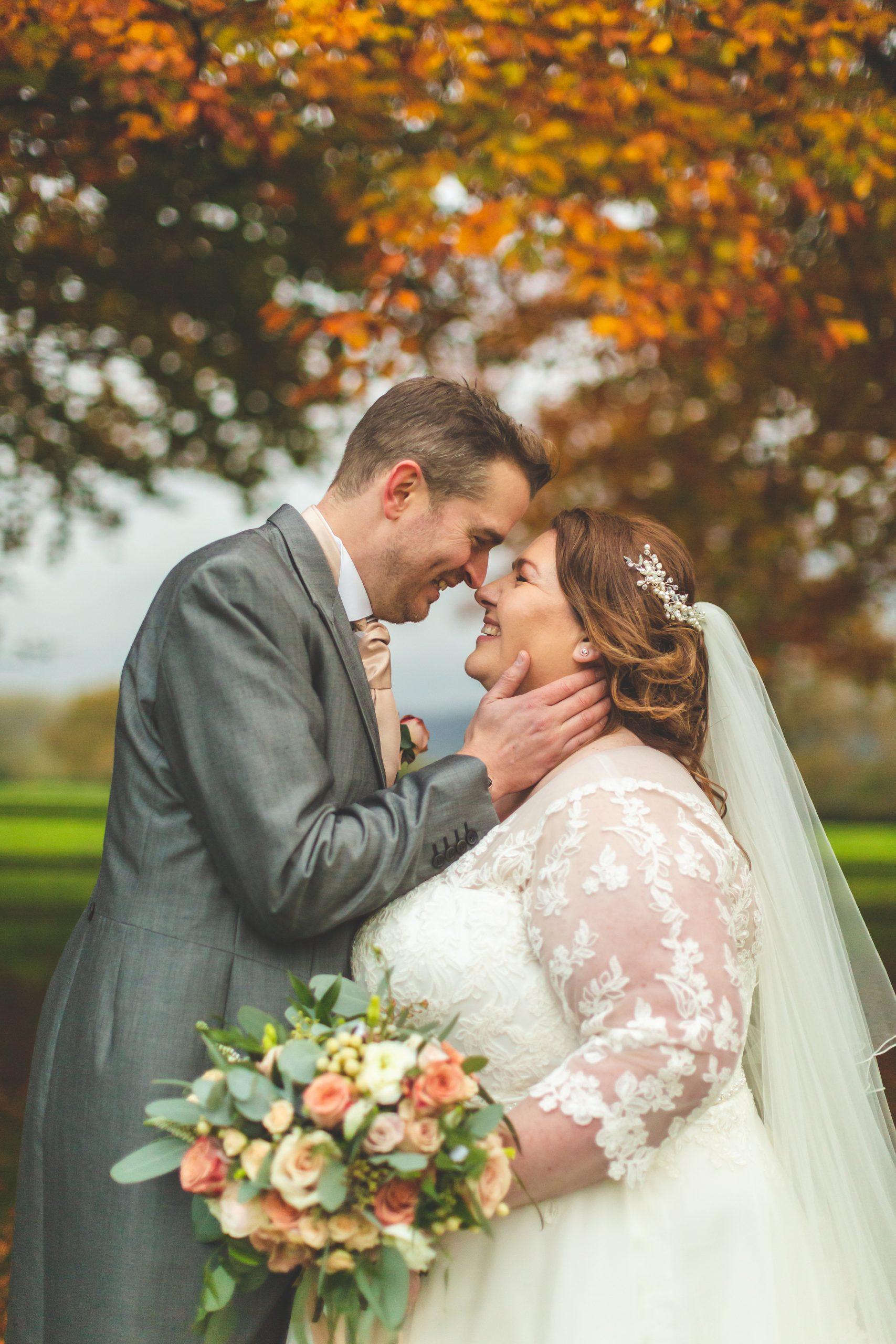 bride and groom embracing eastington park wedding