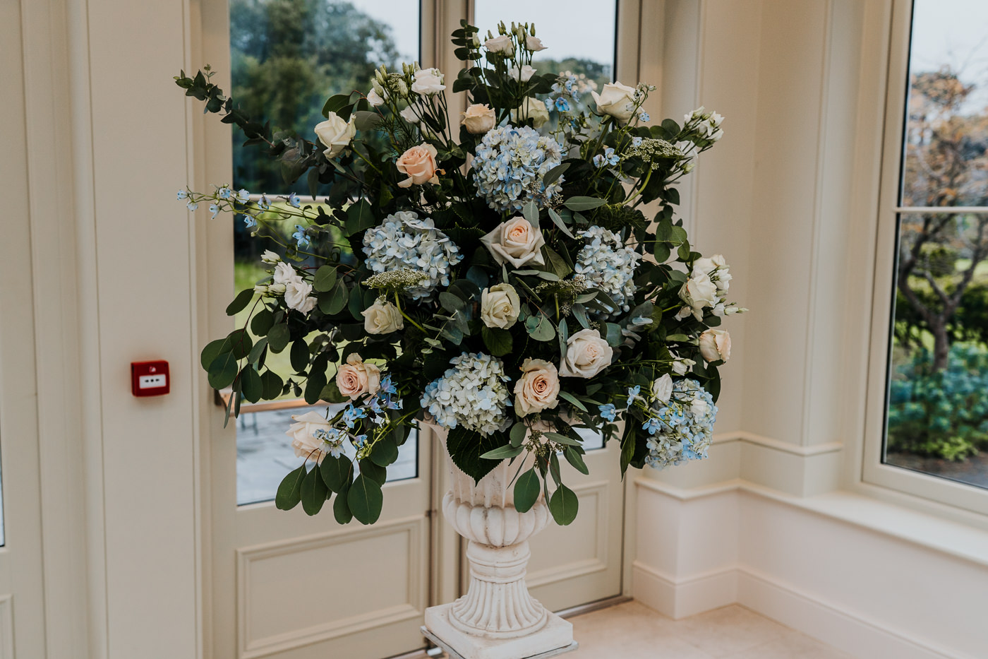 Daisy Lane Floral Design pale blue and blush large urn arrangement