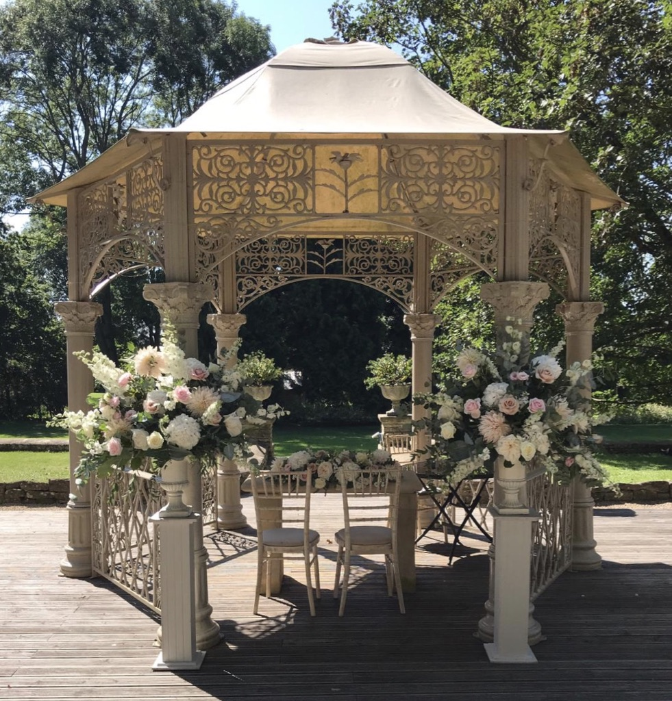 Wedding flowers at Eastington park outdoor ceremony pagoda