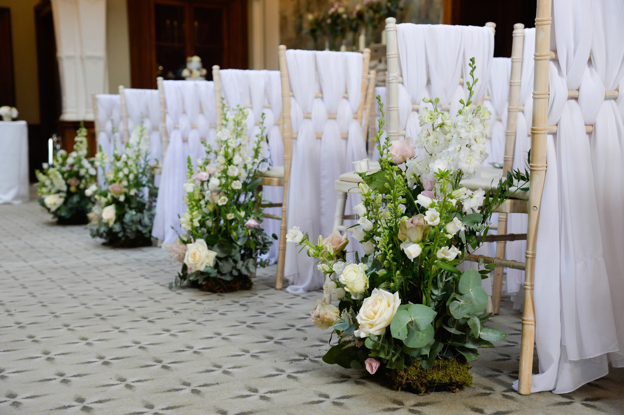 Meadow style floral arrangements ceremony flowers Clevedon Hall