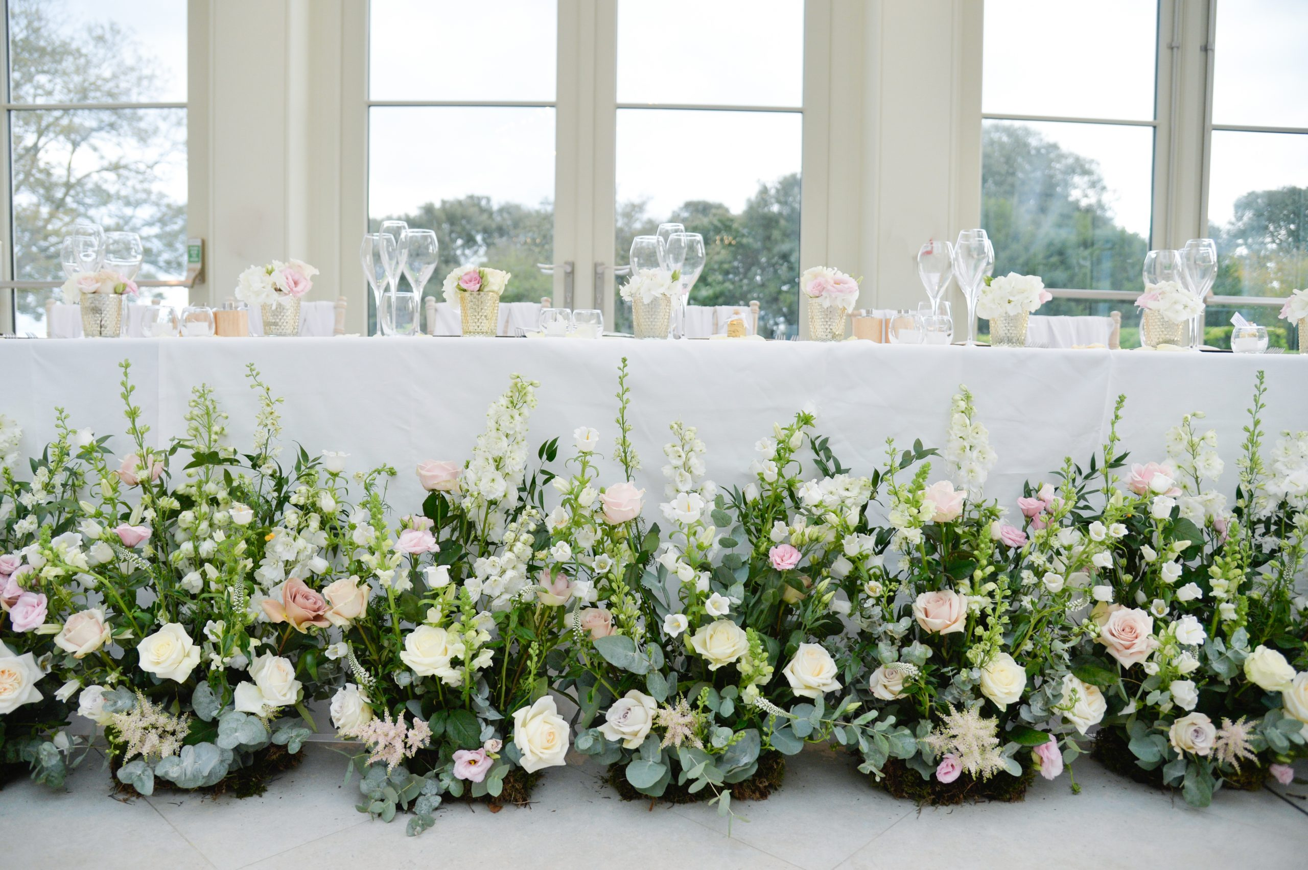 Meadow arrangements top table the orangery Clevedon Hall
