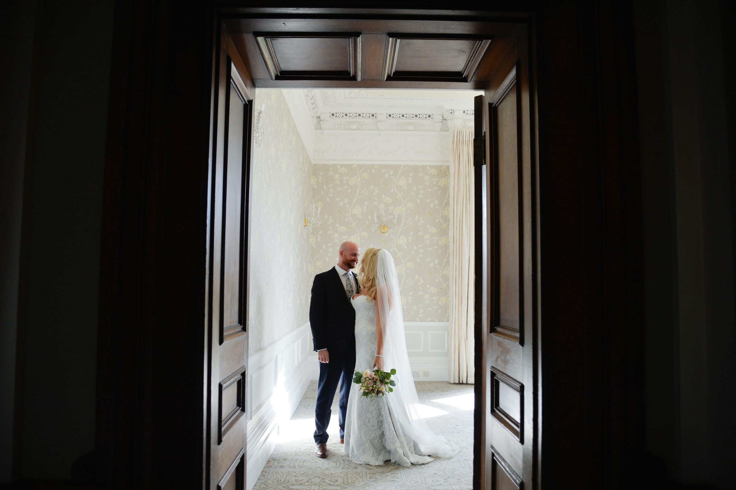 bride and groom in doorway at Clevedon Hall