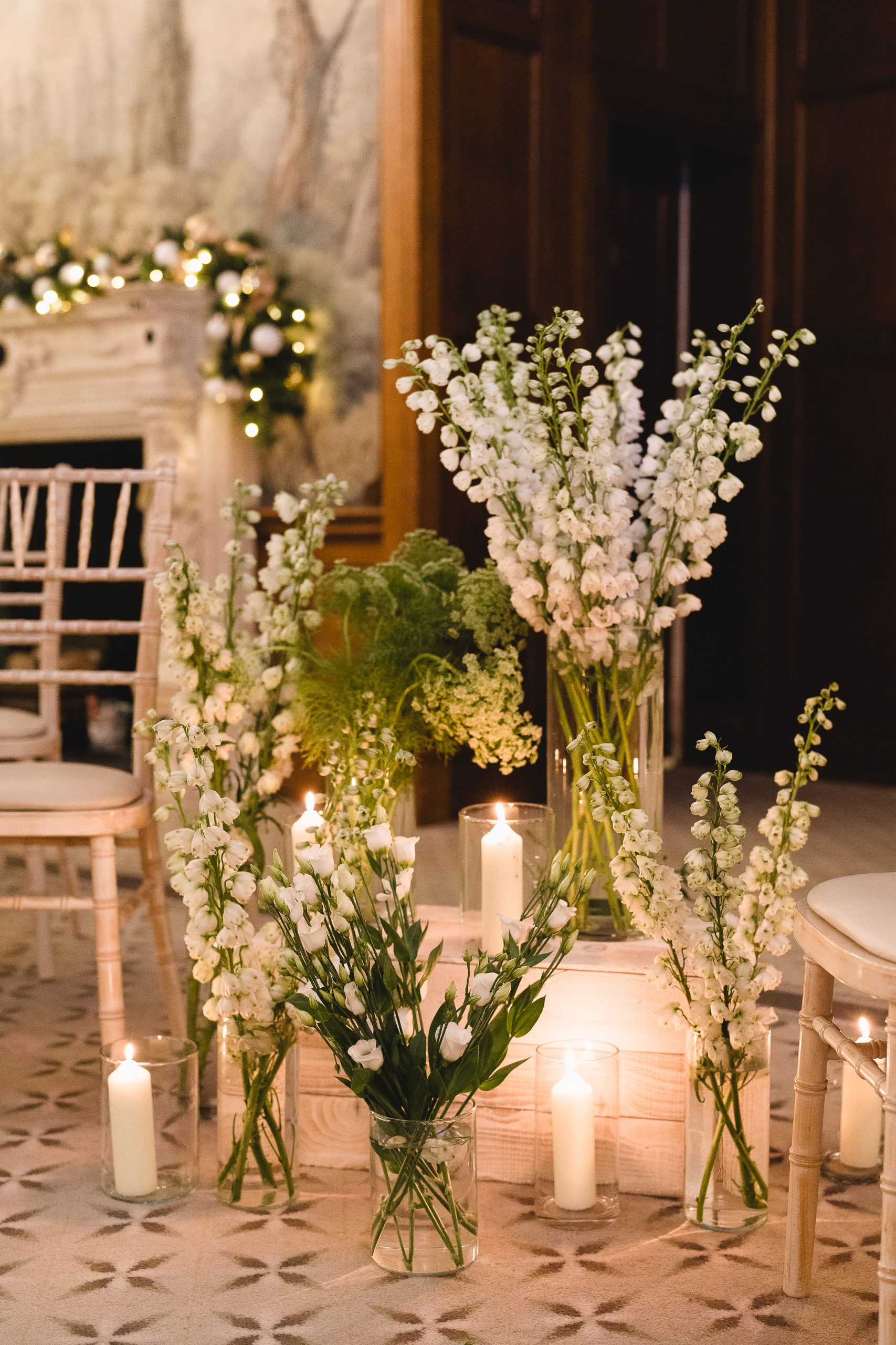 Candles and flowers decorating aisle at wedding ceremony