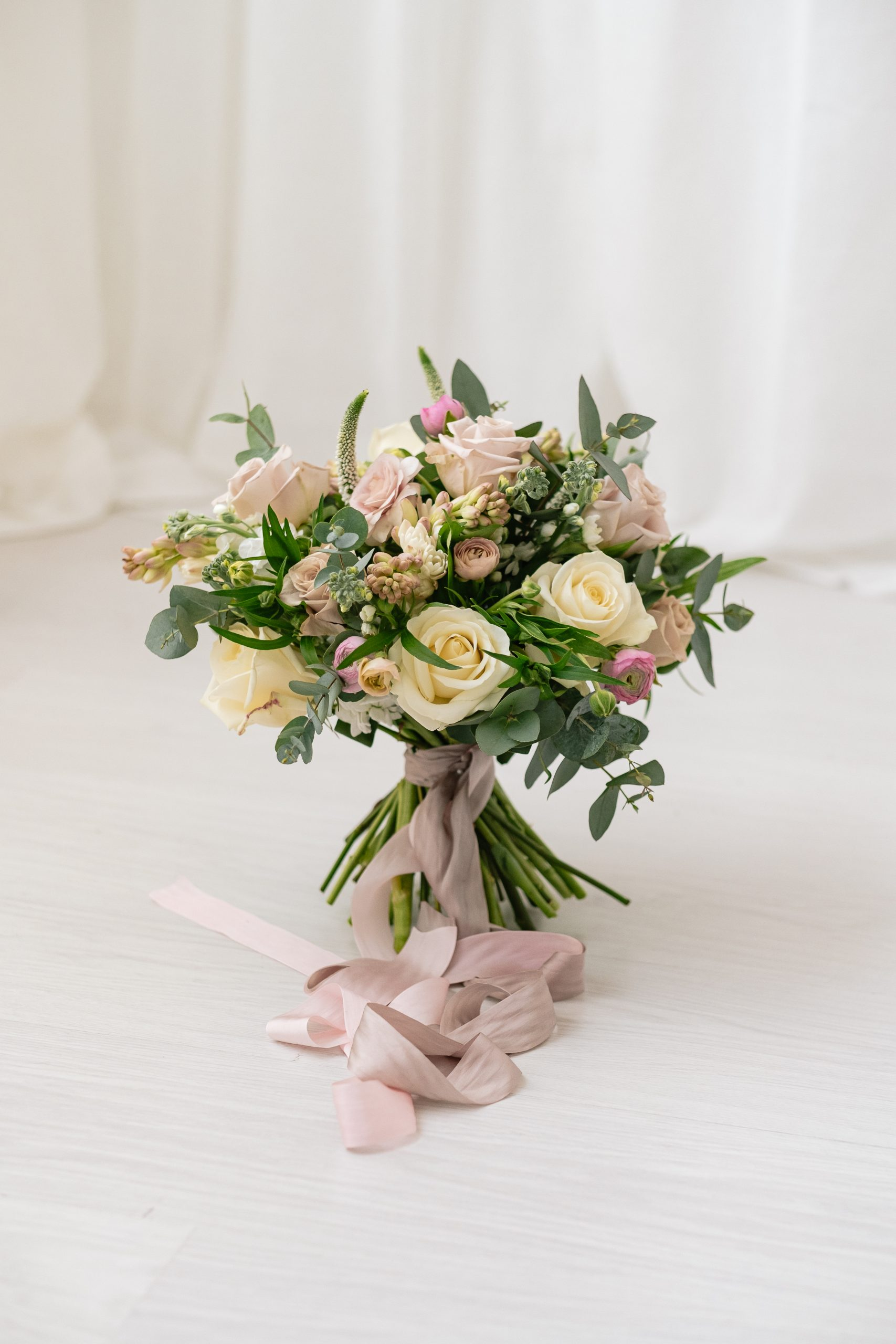 pale pink and ivory bridal bouquet with pink silk trailing ribbon