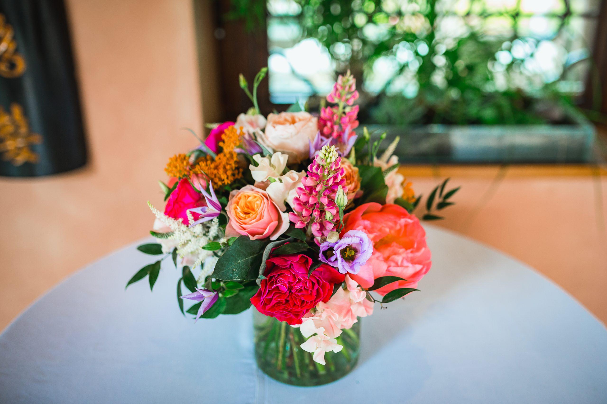 jewel toned wedding bouquet in vase